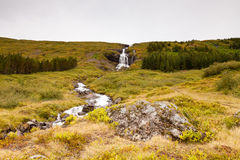 Waterfall in Skutulsfjordur Royalty Free Stock Images