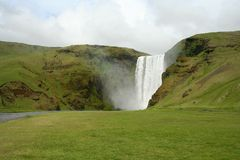 The waterfall Skógafoss is in the south of Iceland Stock Images