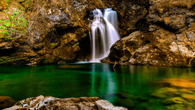Waterfall in Slovenia spring time, Blejski vindgar. Waterfall in Slovenia Stock Photos