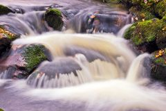 Waterfall in slow motion. Closeup of stream and waterfall in slow motion blur stock photography