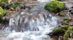 Waterfall. Small waterfall detail - macro settings - hight saturation - nature - rocks Royalty Free Stock Image