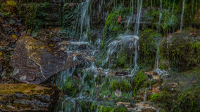 Waterfall. Small waterfall and green stones Stock Photo