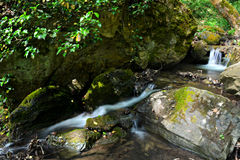 Waterfall. Small waterfall on the mountain royalty free stock photos