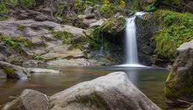Waterfall. Small river in the deep forest turns into charming waterfall Stock Photo