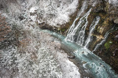 Waterfall and snowy forest Stock Photo