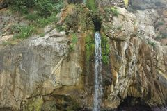 Waterfall on the Sorrento coastline. A small waterfall flowing into the ocean around Sorrento royalty free stock image