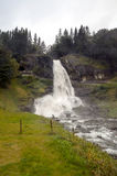 Waterfall in the south of Norway. It`s a vertical image on a cloudy day Stock Photography
