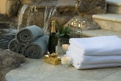 Waterfall spa towels and champagne 10. Spa setting with gift box and towels and champagne Royalty Free Stock Images