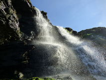 Waterfall. Spacing over the rocks light shinning though Royalty Free Stock Photo