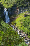 Waterfall Spokoyny in brookvalley at the foot of outer north-eastern slope of caldera volcano Gorely. Royalty Free Stock Images