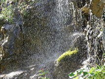 Waterfall spray off mountain rocks Dürrach, dürrach crevice. Here we have a waterfall coming dowm a rockfce in a mountain crevice near the town of Fall Stock Photo