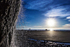 Waterfall Spray on the ORegon Coast. A small waterfall landing on the beach at Hug Point in Oregon Royalty Free Stock Photo