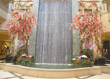Waterfall and spring decorations in the atrium of The Palazzo Resort Hotel Casino in Las Vegas Royalty Free Stock Photos
