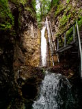 Waterfall. Spring waterfall and a hiking ledder Royalty Free Stock Images