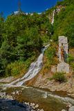 Waterfall and statue in  Borjomi town central park Royalty Free Stock Photos