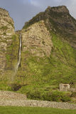 Waterfall and stone house in Flores, Azores. Poco do Bacalhau Royalty Free Stock Photo