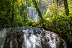 Waterfall from stone monastery.. Stock Photo