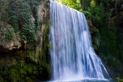 Waterfall from stone monastery.. Royalty Free Stock Images