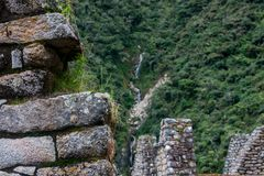 Waterfall from stone ruins Inca town. Ancient stone ruins of an Inca town on the Inca Trail in the Andes mountains. Cusco. Peru. South America. No people stock image