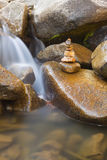 Waterfall with Stone Stack Royalty Free Stock Photography