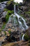 Waterfall stream. Mountain high cliff waterfall stream Stock Image