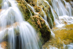 Waterfall and stream closeup in the forest Royalty Free Stock Images
