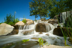 Waterfall Stream over Boulders Stock Images
