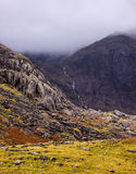 Waterfall streams down a mountain in Snowdonia Stock Photography