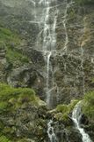 Waterfall strips. Close-up of tiny waterfall mountain source royalty free stock photos