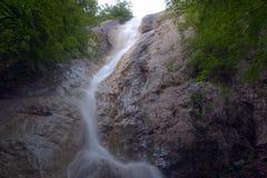 Waterfall Su Ahande. Beautiful ephemeral waterfall in Crimea Royalty Free Stock Image