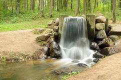 Waterfall in the summer park Stock Image