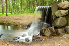 Waterfall in the summer park Royalty Free Stock Photo