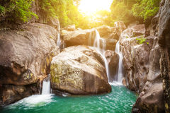 Waterfall and sun. Waterfall photographed with a long exposure and sunset Stock Photo