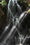 Waterfall with sun rays Stock Photography