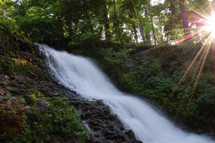 Waterfall and Sunbeams Stock Image