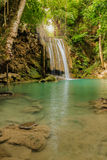 Waterfall with sunbeams Royalty Free Stock Images