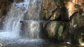 Waterfall sunlight reflections stock video footage