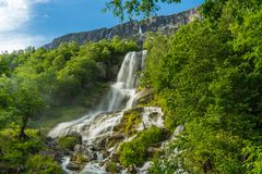 Waterfall in Sunndal Norway with smooth and soft water royalty free stock image