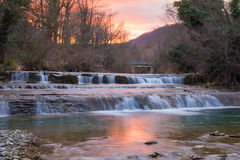 Waterfall at the sunset Royalty Free Stock Photos
