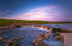Waterfall in sunset light Royalty Free Stock Images