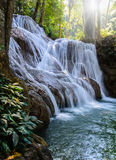 Waterfall and sunshine. Beautiful waterfall in deep forest, Thailand Stock Photo