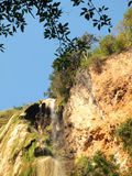 A waterfall surrounded of tropical vegetation. Nature stock photography