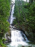 Waterfall Surrounded by Wooded Wilderness Royalty Free Stock Photos