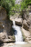 Waterfall and a suspension bridge near the Dryanovo monastery in Bulgaria Royalty Free Stock Images