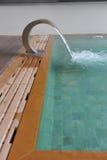 Waterfall in swimming pool. The waterfall in swimming pool Stock Photo