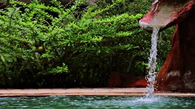 Waterfall for swimming pool. Waterfall installation for swimming pool stock video