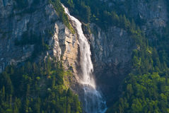 Waterfall at the swiss alpes Stock Images