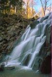 Waterfall on the taiga river in late autumn. Stock Photo