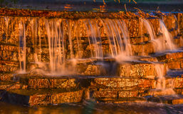 Waterfall taken at twilight. With shimmering stones Stock Photo