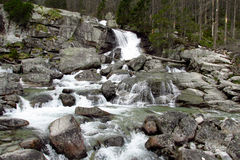 Waterfall in Tatra Mountains among the stones Royalty Free Stock Photo